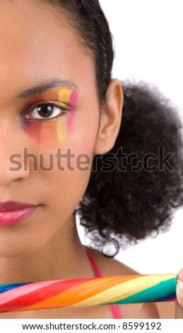 Beautiful girl with candy striped makeup on her face