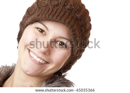 Beautiful girl with cap smiles happy. Isolated on white background. - stock photo