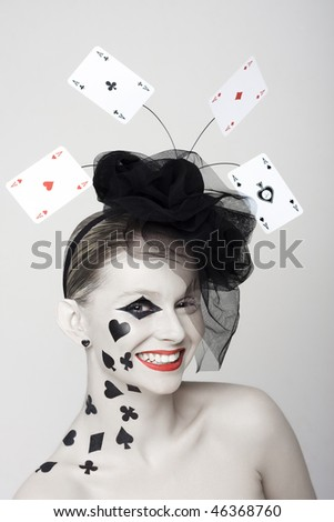 Beautiful girl with cap with play-cards and painted - stock photo