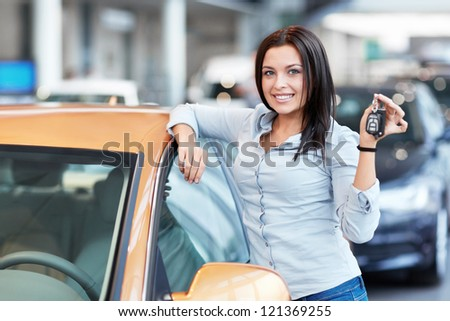 Beautiful girl with car keys - stock photo
