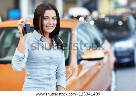 Beautiful girl with car keys