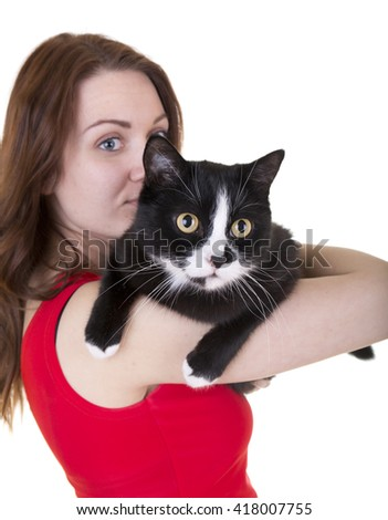 beautiful girl with cat on white background in Studio - stock photo