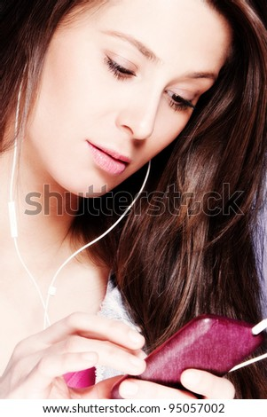 beautiful girl with cell phone and earphones - stock photo