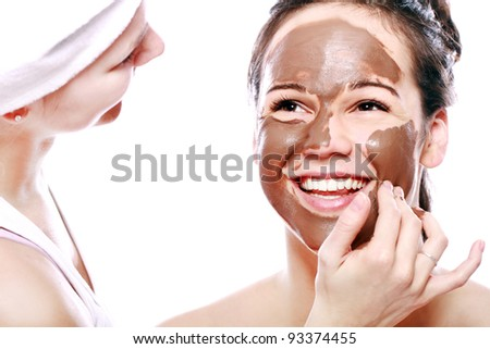 Beautiful Girl with chocolate mask on her face - stock photo