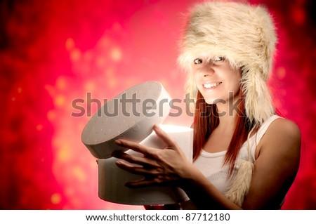 Beautiful Girl with Christmas Holidays Gift. Beautiful christmas woman series  - stock photo