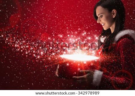 Beautiful girl with christmas magic box - stock photo