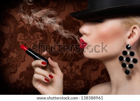 Beautiful girl with cigarette and red lips   - stock photo