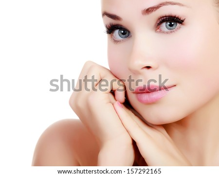 Beautiful girl with clean fresh skin, white background, copyspace  - stock photo