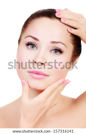 Beautiful girl with clean fresh skin, white background, copyspace.  - stock photo