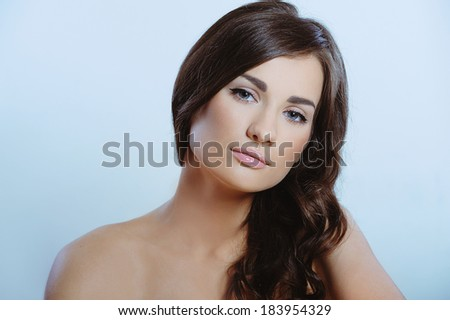 Beautiful  girl with clean pure skin and  long groomed hair - stock photo