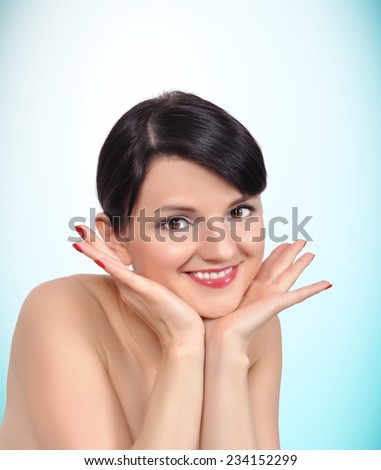 Beautiful girl with clean skin on blue background - stock photo