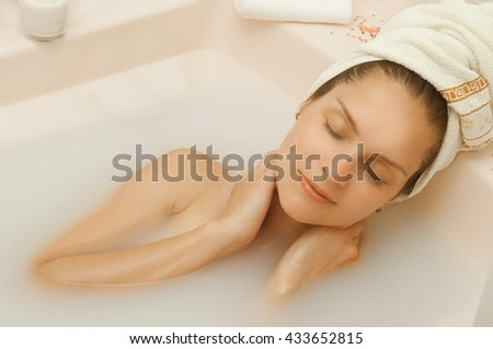 beautiful girl with closed eyes in milk bath