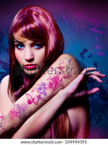 beautiful girl with colored hair and tattoo - stock photo