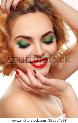 Beautiful girl with colorful makeup and manicure, close up