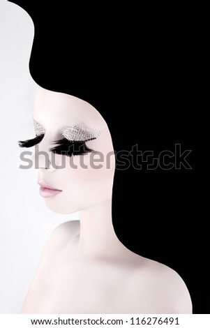 beautiful girl with crystals on the eyelids - stock photo