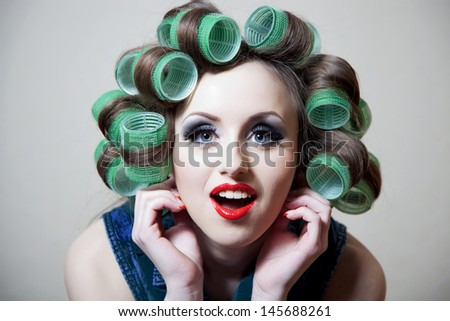 beautiful girl with curlers on her head, a large portrait - stock photo