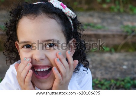 Beautiful girl with curly hair laughing