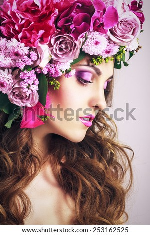 Beautiful Girl With Different Flowers.Beauty Model Woman Face. Perfect Skin. Glamour style Fashion Portrait. - stock photo