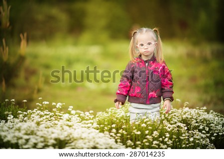 beautiful girl with Down syndrome - stock photo