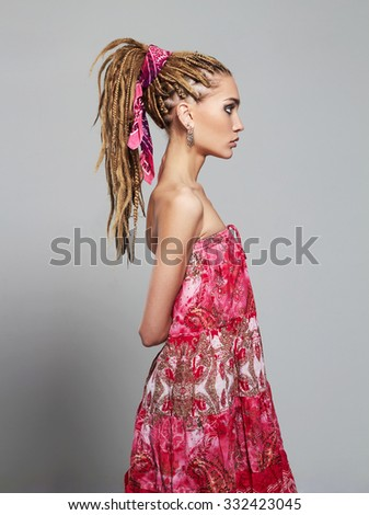 beautiful girl with dreadlocks. pretty young woman with African braids hairstyle. hippies - stock photo