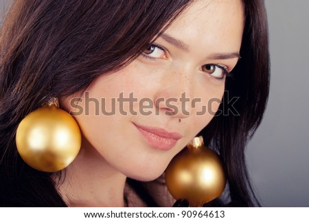 beautiful girl with earrings of Christmas toys