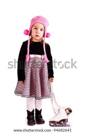 Beautiful girl with figure skates isolated over white background - stock photo