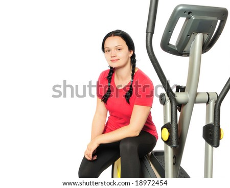 Beautiful girl with fitness machine over white background - stock photo