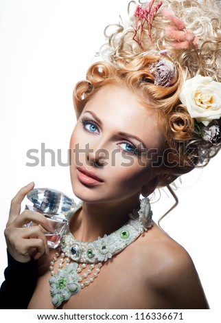 Beautiful girl with floral perfume - stock photo