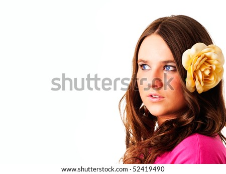 beautiful girl with flower in hair looking right with place for text