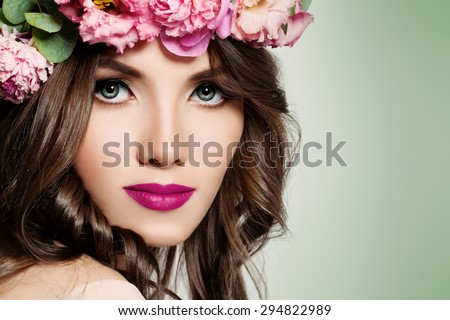 Beautiful Girl with Flowers. Face Closeup. Makeup and Hairstyle