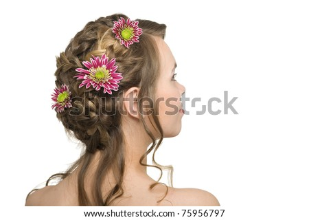 Beautiful girl with flowers in their hair.