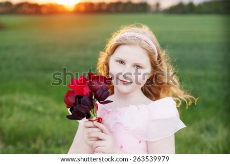 beautiful girl with flowers outdoor - stock photo