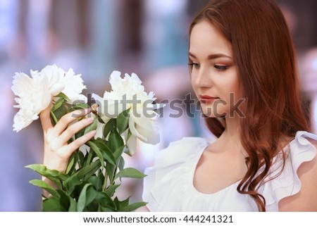 Beautiful girl with fresh spring bouquet