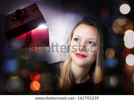 Beautiful girl with Gift. - stock photo