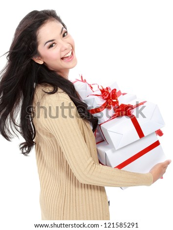 Beautiful girl with gift box isolated over white background - stock photo