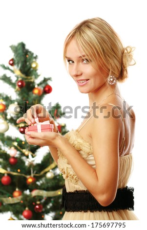 Beautiful girl with gift christmas decorated background - stock photo