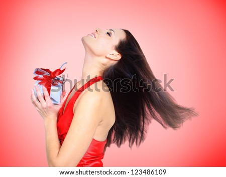 Beautiful girl with gifts. - stock photo