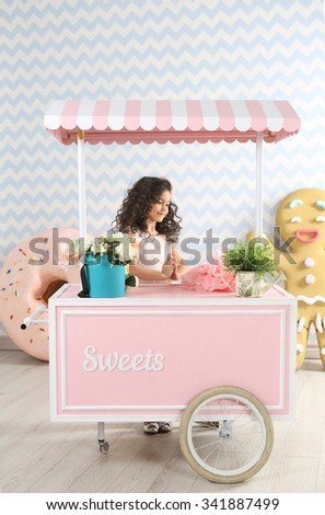 Beautiful girl  with ginger man and donut on the background. Pink truck  - stock photo