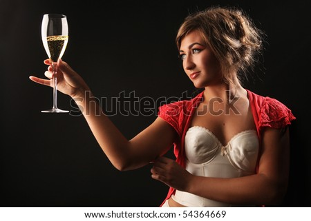 beautiful girl with glass of champagne on black - stock photo