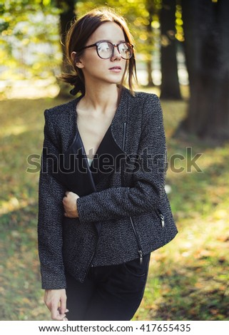 beautiful girl with glasses in the park in spring - stock photo