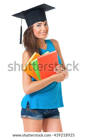 Beautiful girl with graduation hat holding book, isolated on white background