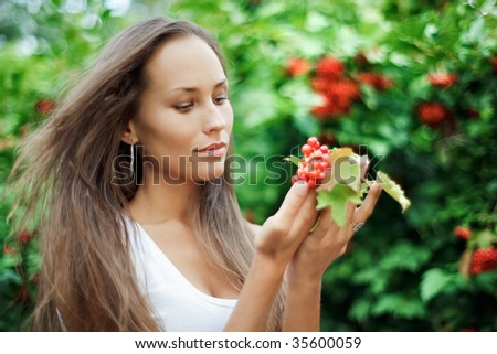 Beautiful girl with guelder rose - stock photo