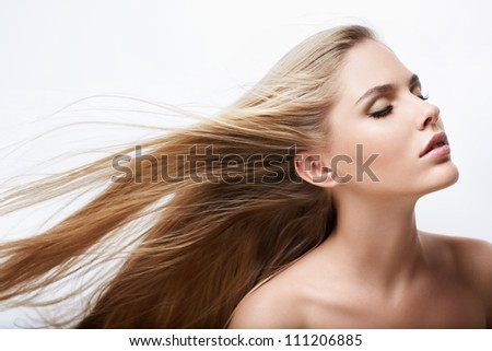 Beautiful girl with hair flying - stock photo