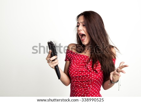 Beautiful girl with hair loss is shocked - stock photo