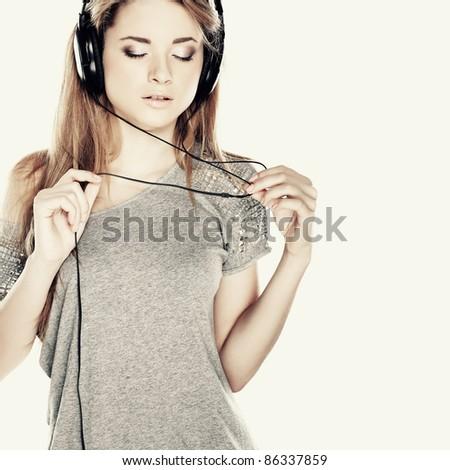 Beautiful girl with headphones - stock photo