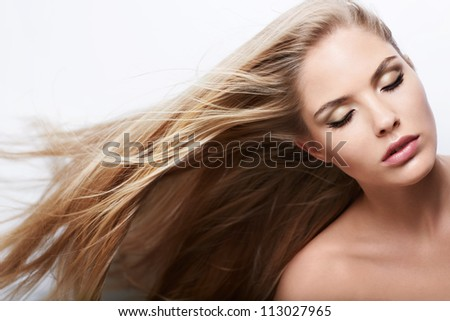 Beautiful girl with healthy hair flying - stock photo