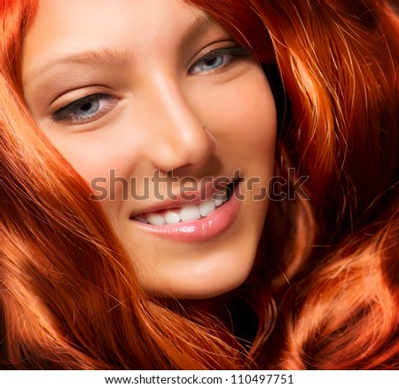 Beautiful Girl With Healthy Long Red Curly Hair. Extension - stock photo