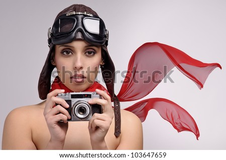 Beautiful girl with helmet and goggles and a camera - stock photo