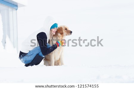 Beautiful Girl with her dog in winter outdoors - stock photo
