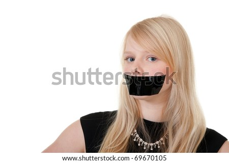 beautiful girl with her mouth sealed with black tape
